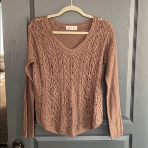 Long sleeve brown knit sweater.